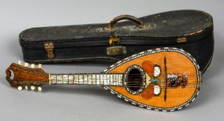 A 19th century tortoiseshell and mother-of-pearl inlaid mandolin Decorated to the front with a
