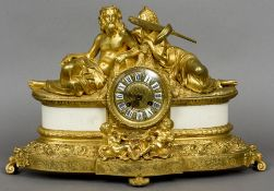 A gilt bronze mantel clock Decorated with ancient figures and putto.  49 cm wide.