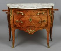 A 19th century marble topped ormolu mounted bombe commode The shaped marble top above a slide over