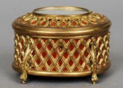 A 19th/20th century gilt metal casket by Tahan, Paris The oval hinged cover set with a mirror,