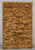 A Chinese canton carved wood card case Profusely worked with figures in a village scape.