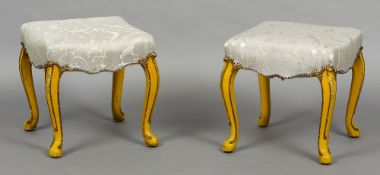 A pair of 19th century upholstered painted stools Each overstuffed seat standing on scroll carved