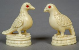 A pair of small 19th century carved ivory models of birds  Each naturalistically modelled,