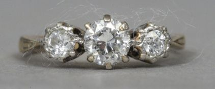 An 18 ct gold diamond three stone ring  CONDITION REPORTS: Some inclusions,