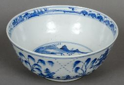 A Chinese blue and white porcelain bowl Decorated with figures and pagodas in a continuous