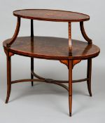 A Victorian inlaid two tier centre table Of typical oval form with scrolling swag inlays.  88.
