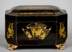 A Chinese Export lacquered tea caddy Typically decorated and enclosing a pair of white metal lidded