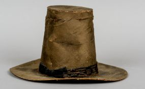 A 19th century Welsh ladies silk top hat Of typical broad rimmed form, with a bow tied ribbon.