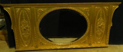 A 19th century gilt overmantle mirror The circular bevelled mirror plate flanked by musical trophy