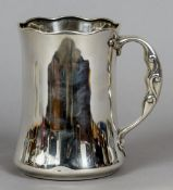 An early 20th century American Sterling silver Arts & Crafts quart tankard Of waisted form,