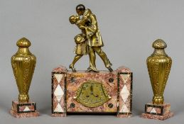 An Art Deco gilt Art metal mounted red marble triple clock garniture Surmounted with Pierrot and