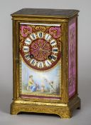 A 19th century ormolu and porcelain mantel clock The engraved ormolu case fitted with Sevres type