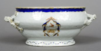 An 18th century Chinese Export sauce tureen With twin loop handles and armorial decoration.
