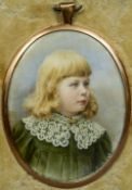 An unmarked yellow metal framed portrait miniature of a young girl With lace collar,