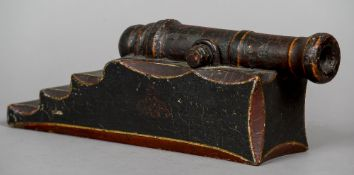 A 19th century decorated table canon The barrel supported on a stepped base.  38 cm long overall.