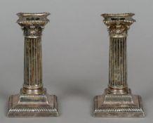 A pair of Victorian silver candlesticks, hallmarked London 1893,