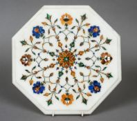 An octagonal white marble specimen stone inlaid panel 30.5 cm wide.