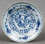 A 19th century Delft blue and white dish With flared rim and floral decoration.  30 cm wide.