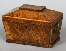 A 19th century burr walnut tea caddy Of sarcophagus form.  21.5 cm wide.