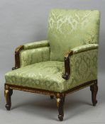 A pair of 19th century gilt metal mounted mahogany framed armchairs Each with padded back and twin