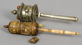 Two Tibetan prayer  wheels One white metal with cabochon mounts, the other stained bone and carved.