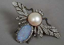 An unmarked gold and silver, diamond, opal and pearl set pendant/brooch Formed as a butterfly.