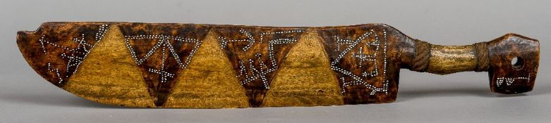 A tribal ceremonial wooden sword With inlaid shell decoration.  62 cm long.