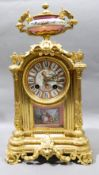 A 19th century Sevres type porcelain inset ormolu cased eight day mantel clock The porcelain dial