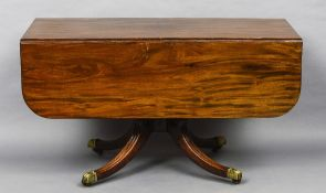 A 19th century mahogany pedestal Pembroke table Of large proportions,