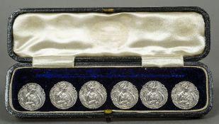 A cased set of six Art Nouveau silver buttons, hallmarked Birmingham 1902,