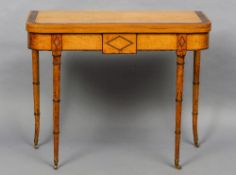 A 19th century birdseye maple card table The crossbanded hinged folding rounded rectangular top