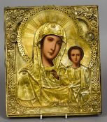 A brass clad Russian icon Of typical religious form.  36 cm high.