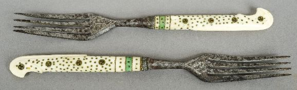 Two early pique inlaid bone handled forks Each with further engraved decoration.