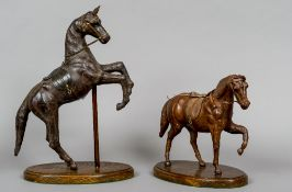 Two leather covered horse models One modelled rearing, the other with one leg raised,