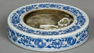 A Chinese blue and white porcelain ink pot The central well with two further leaf moulded wells,