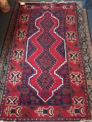 A Caucasian wool rug The wine red field enclosing a central pole medallion within geometric guard