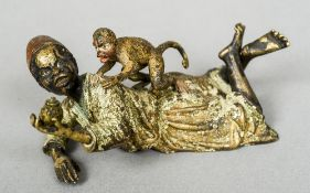 A cold painted group Formed as a North African boy and a monkey.  10 cm wide.