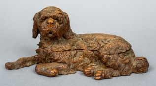 A late 19th century Black Forest carved double inkwell Modelled as a recumbent shaggy dog.  28.