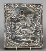 A Russian silver clad painted icon Worked with St. George and the Dragon.  18.5 x 21 cm.