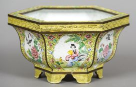 A Chinese Canton enamelled jardiniere Of hexagonal form, decorated with figural and bird vignettes,