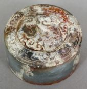A Chinese carved hardstone seal Of circular section, carved with a dragon,