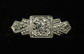 An Art Deco 9 ct gold platinum three stone diamond ring CONDITION REPORTS: Overall