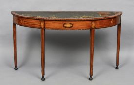 A 19th century satinwood demi-lune side table The leather inset top above the patera inlaid frieze,