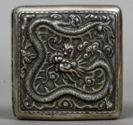 A Chinese unmarked white metal, probably silver, cigarette case Decorated to one side with a dragon,