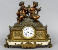 A three piece bronze and white marble clock garniture The clock mounted with musical putto,