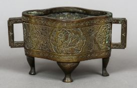 A 19th century Chinese bronze censor Of lobed form with twin angular handles,