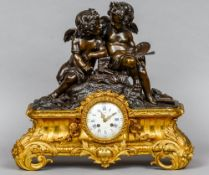 A gilt metal bronze mounted mantel clock, retailed by Clermont,