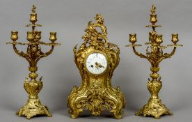 A gilt bronze three piece clock garniture in the rococo style The clock 50 cm high.