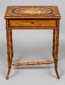 A 19th century Continental inlaid bamboo side table The inlaid hinged top enclosing a mirror and a