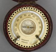 A 19th century carved and pierced ivory pocket thermometer/compass by Marratt of London In original